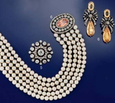 A topaz, diamond and cultured