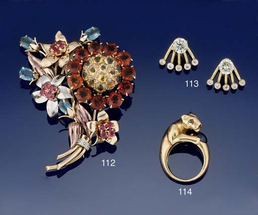 AN 18CT. GOLD AND GEM RING, BY