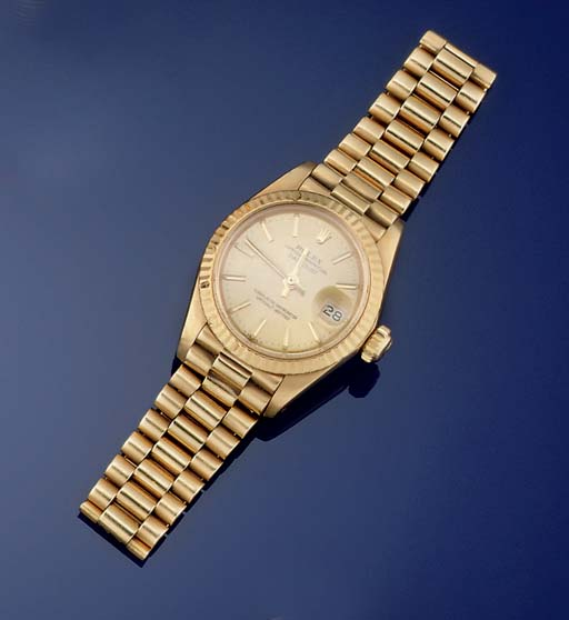 A LADY'S 18CT. GOLD AUTOMATIC