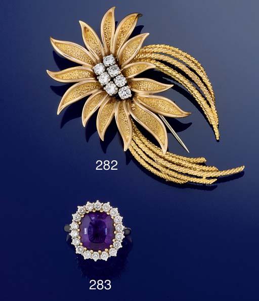 A DIAMOND SET FLOWER BROOCH, B
