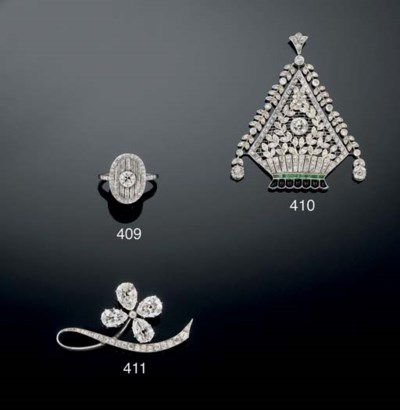 A DIAMOND AND GEM PENDANT