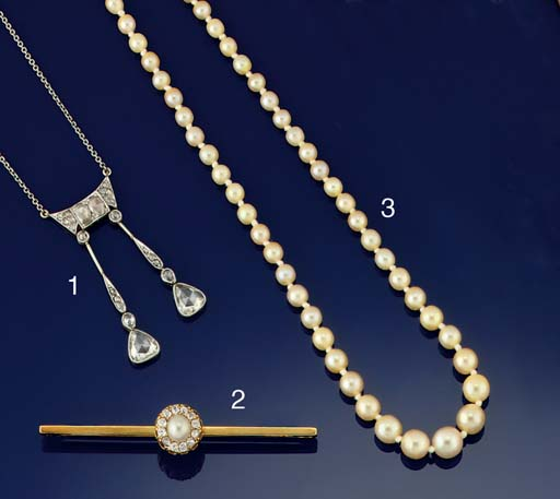 A PEARL NECKLACE TO A DIAMOND SINGLE STONE CLASP BY TIFFANY & CO.