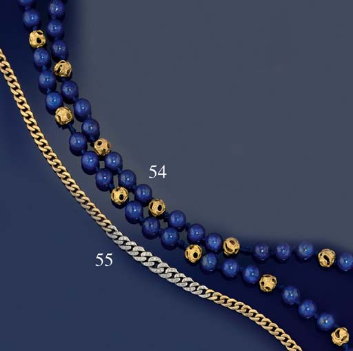 A lapis lazuli and textured bead necklace