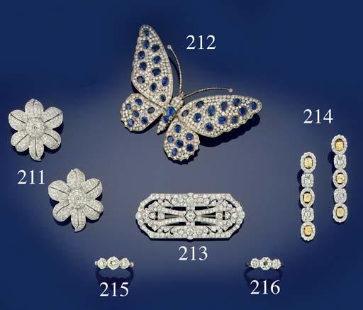 A pair of diamond flowerhead earclips