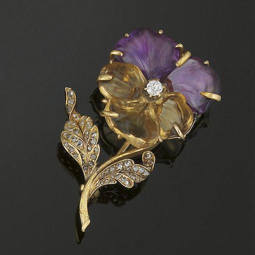 A gemstone and diamond flower