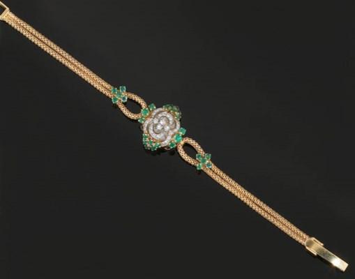 A lady's emerald and diamond c