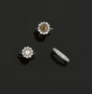 Three diamond and gem-set ring