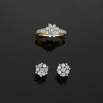 A diamond ring and a pair of m