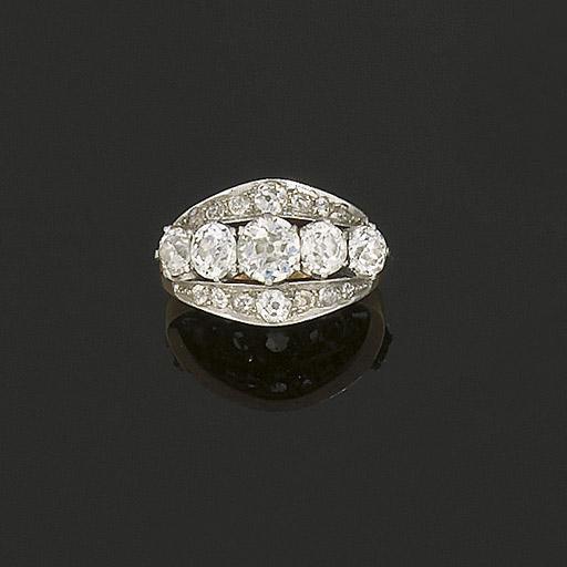 A diamond triple row ring