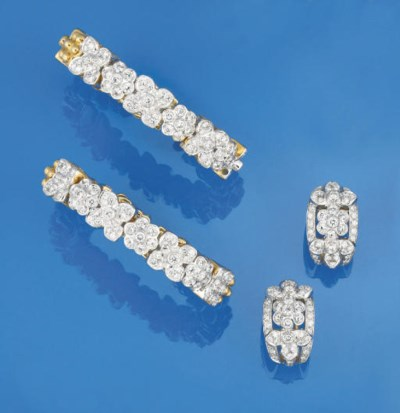 TWO DIAMOND BANGLES AND A PAIR