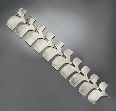 A SILVER BRACELET, DESIGNED BY