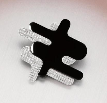 A DIAMOND AND ONYX BROOCH, BY