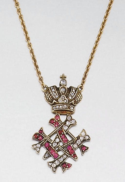AN EARLY 20TH CENTURY RUBY AND