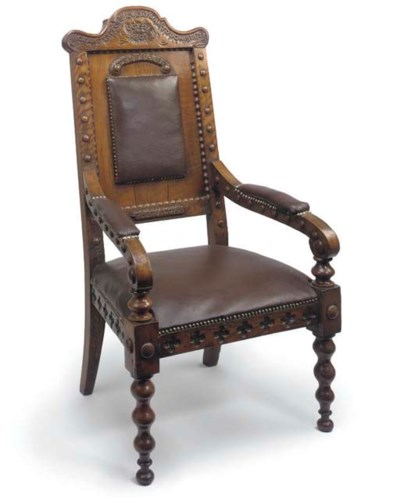 AN EARLY VICTORIAN ARM CHAIR M