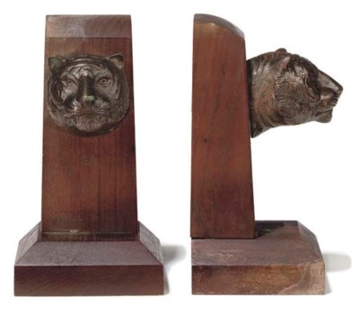 A PAIR OF BOOKENDS MADE FROM T