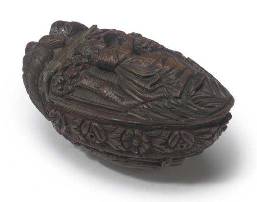 A 19TH-CENTURY CARVED COQUILLA