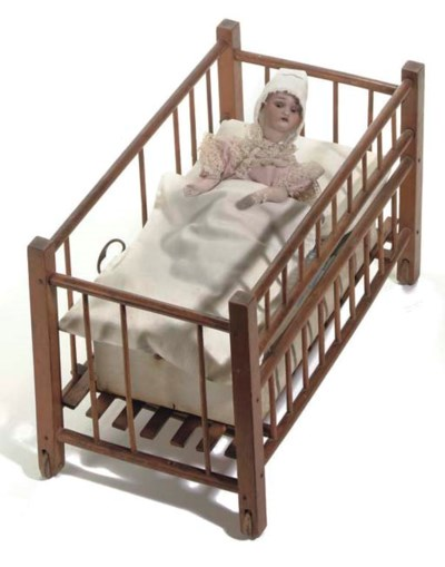 An unusual doll-in-bed musical
