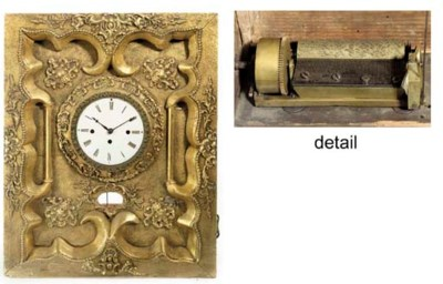 A gilt-framed musical timepiec
