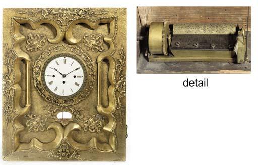 A gilt-framed musical timepiece