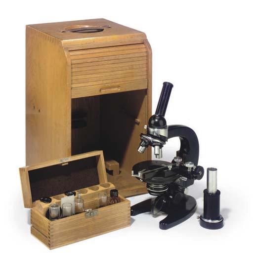 A compound monocular black enamel 'Routine' microscope,