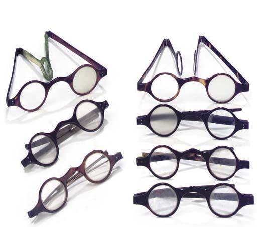 Thirteen tortoiseshell spectacles,