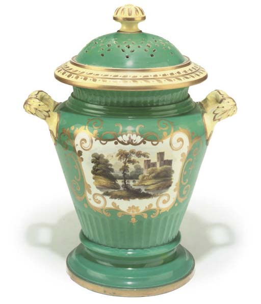 A large staffordshire green ground earthenware leech jar with perforated cover,