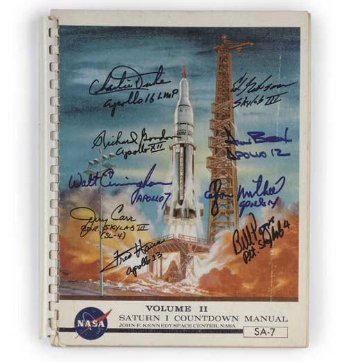 an apollo saturn 1 rocket countdown manual autographed by several apollo pilots,