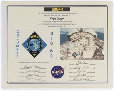 a flown columbia sts-62 flag,