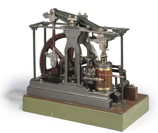 a mid 19th century model centre frame reversing beam engine