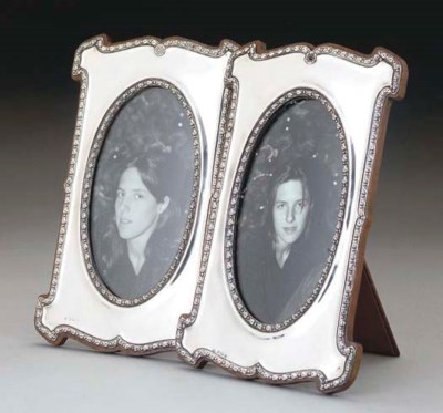 A PAIR OF SILVER SHAPED OBLONG