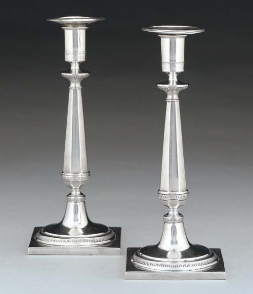 A PAIR OF EARLY 19TH CENTURY GERMAN SILVER CANDLESTICKS,