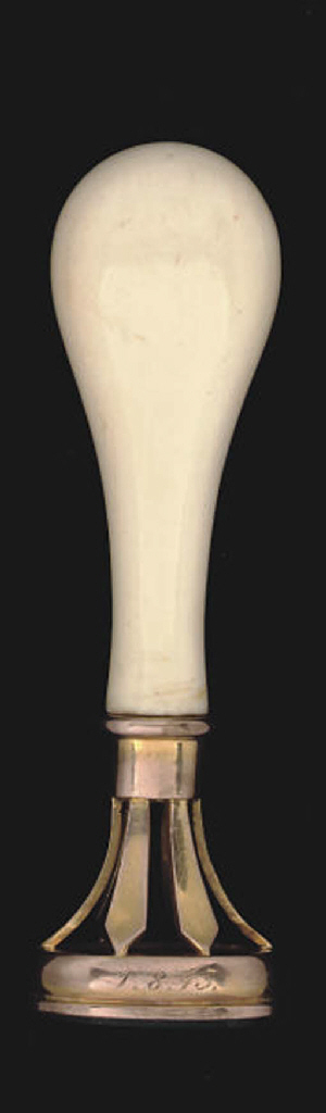 An ivory-handled gold desk seal