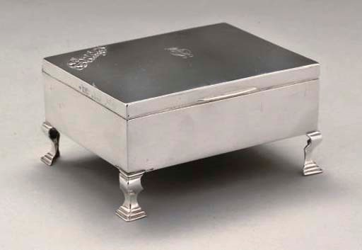 A SILVER PLAYING CARD BOX
