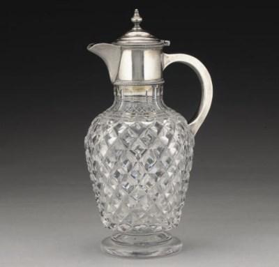 A SILVER-MOUNTED CUT GLASS CLA