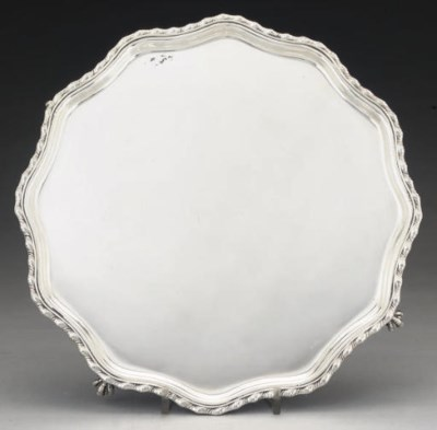 A SILVER SALVER ON CLAW AND BA