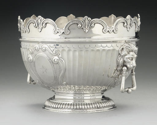 A SILVER ROSE BOWL IN THE FORM