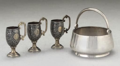 Three Russian silver-gilt and niello vodka cups