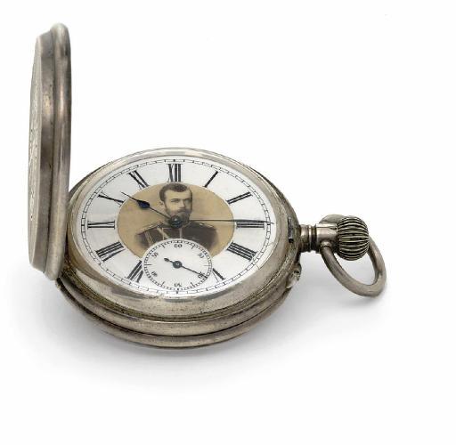 A silver fob watch