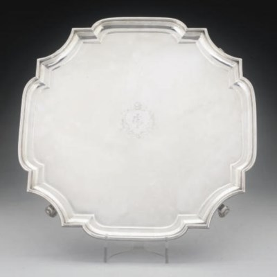 A SILVER SALVER WITH MOULDED B
