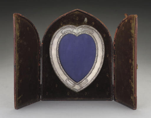 A SILVER HEART-SHAPED PHOTOGRAPH FRAME,