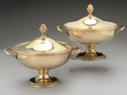 A PAIR OF ITALIAN TWO-HANDLED SILVER-GILT TUREENS AND COVERS