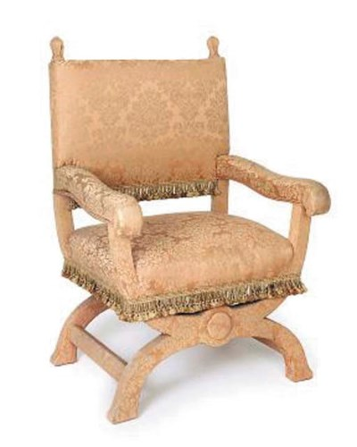 AN UPHOLSTERED THRONE CHAIR