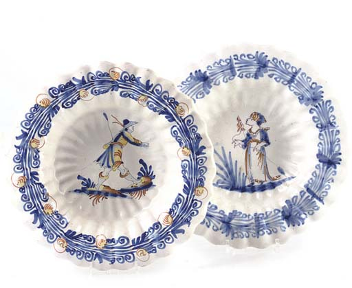 TWO FAIENCE FLUTED DISHES