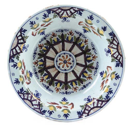 A LONDON DELFT DEEP DISH OF 'ANN GOMME' TYPE