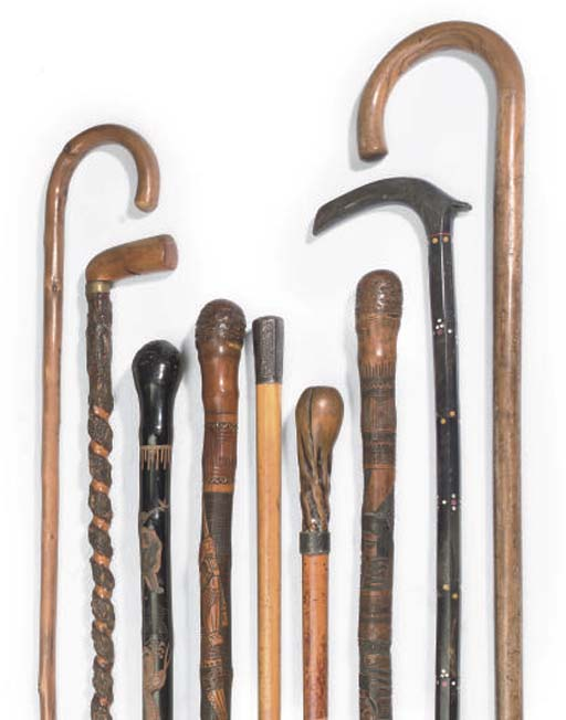 NINE WALKING STICKS OF VARIOUS