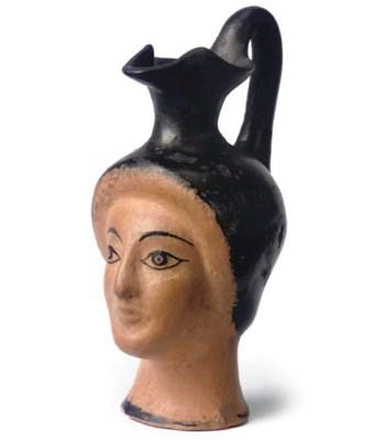 AN ATTIC POTTERY 'HEAD' OINOCH