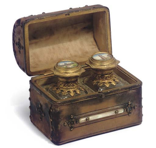 A LEATHER COVERED SCENT BOX