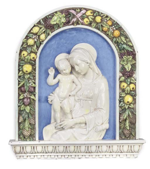 A GLAZED EARTHENWARE RELIEF OF
