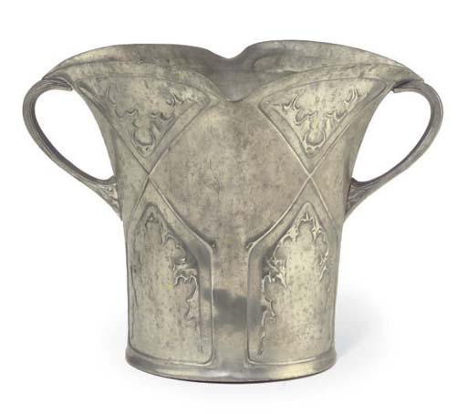 A TWIN-HANDLED PEWTER VASE