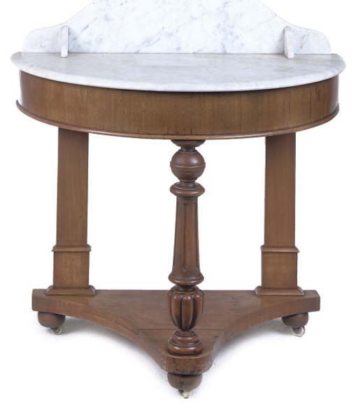 AN EARLY VICTORIAN MAHOGANY DEMI-LUNE WASHSTAND